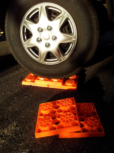 Stack the interlocking blocks to create a solid 'ramp' on which to park.