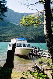 We stroll over to the dock to take in a boat ride on St. Mary Lake. It's a leisurely cruise along the long and narrow glacier-carved valley, over emerald waters made milky by finely pulverized rocks up on the mountains.