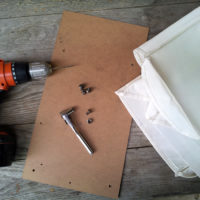 "10 x 18"" fiberboard, and four small bolts and nuts"